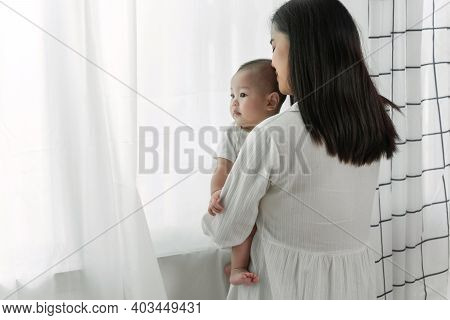 Young Beautiful Aisan Mother With Her Little Cute Newborn Baby 0-1 Month At Home And Mother Hold New