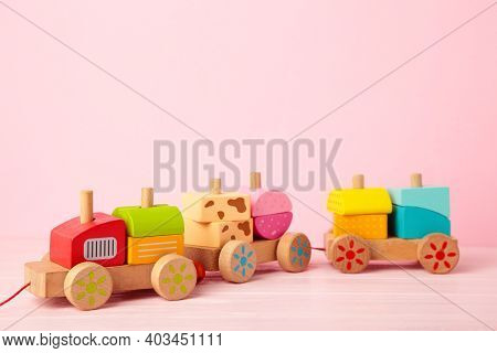 Stacking Train Toddler Toy For Little Children On Pink Background With Shadow Reflection. Baby Train