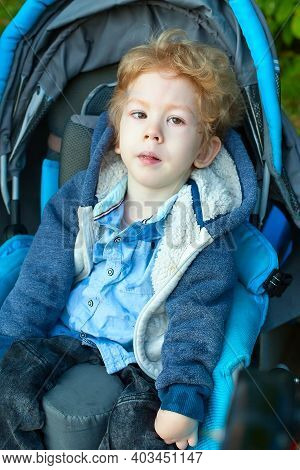Four Year Old Boy With Cerebral Palsy Sitting In Carseat
