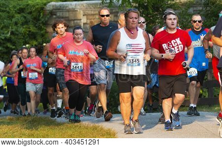 North Babylon, New York, Usa - 8 July 2019: Many Runners In The Mid Pack Of A Crowded Race Racing In
