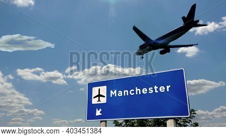Plane Landing In Manchester England Airport With Signboard