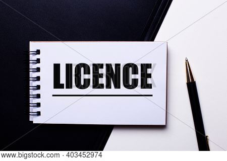 The Word Licence Written In Red On A Black And White Background Near The Pen