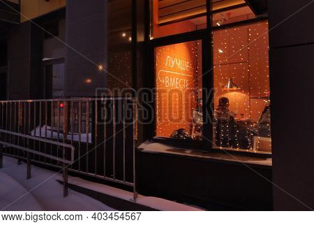 Russian Federation, Moscow, 14.01.2021: Better Together - On The Wall. Evening The Window Of The Caf