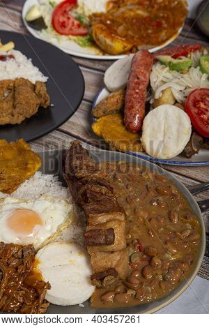 Variety Of Typical Dishes Of Colombian Gastronomy. Picada, Tripe, San Cocho, Paisa Tray.