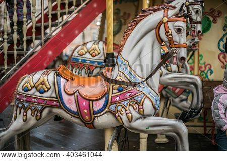 Colorful Carousel Horse On A Vintage Illuminated Roundabout Carousel