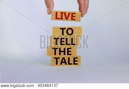 Live To Tell The Tale Symbol. Wooden Blocks With Words 'live To Tell The Tale' On Beautiful White Ba
