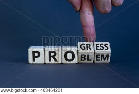 Problem Or Progress Symbol. Businessman Hand Turns Wooden Cubes And Changes The Word 'problem' To 'p