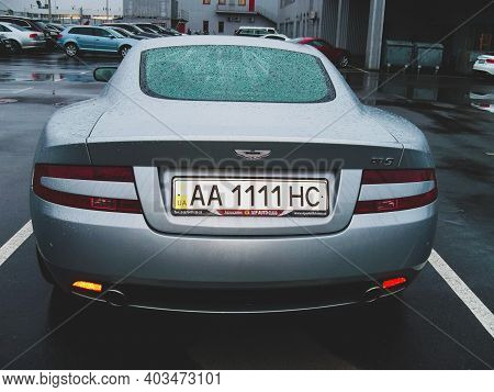 Kiev, Ukraine - April 8, 2011: English Supercar Aston Martin Db9 In Raindrops