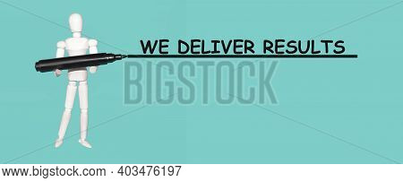 White Mannequin Man Holds Marker. Text We Deliver Results