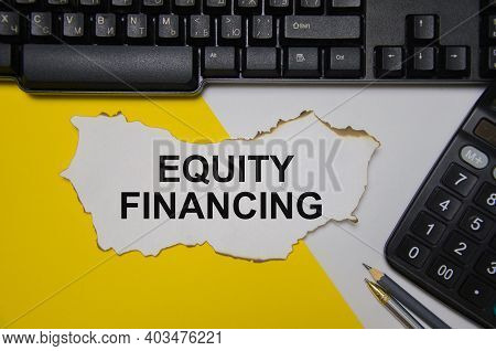 Equity Financing Text Is Written On A White Sheet Of Paper Near Lies A Calculator And A Computer On