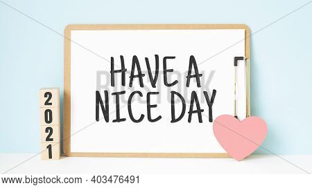 Have A Nice Day Words And 2021 Cubes With Red Heart Shape Decoration On Blue Wooden Table Background