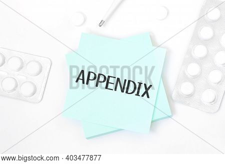Blue Card With Text Appendix On A Table With A Pills And Pencil, Medical Concept, Top View