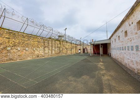 Courtyard With Barbed Wire Of Fremantle Prison Historic Building, Unesco World Heritage And One Of M