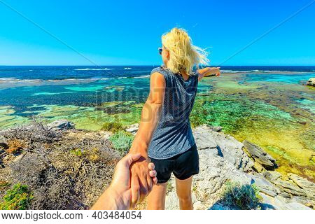 Follow Me, Girl Holding Hand At Above Promontory Of Jeannies Lookout At Rottnest Island, Western Aus