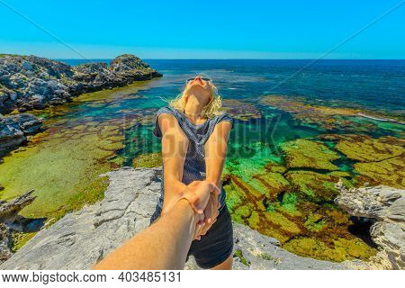 Follow Me. Blonde Woman Holding Hand Of Her Friend Of Hers At Rottnest Island, Perth, Western Austra