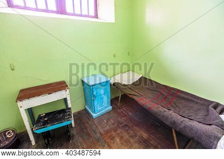Fremantle, Western Australia - Jan 5, 2018: Single Cell With Bed And Bedside Table Of Fremantle Pris