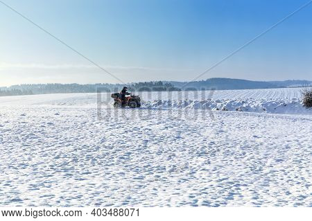 All Terrain Vehicle In Motion At Winter. Quad Bikers On The March. Travel. Tourism. Quad Bike Driver