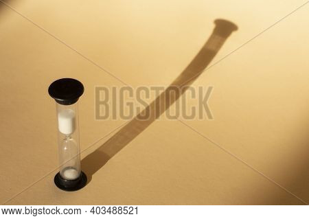 Hourglass As A Concept Of Passing Time For Business Term, Urgency And Outcome Of Time.shadows