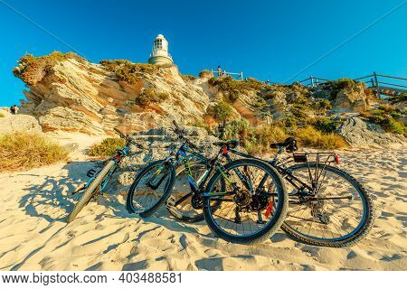 Rottnest Island, Western Australia - Jan 4, 2018: Tourist Bicycles Parked At Bathurst Lighthouse In