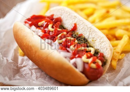Hotdog With Fries, Sauce And French Fries. High Quality Photo.