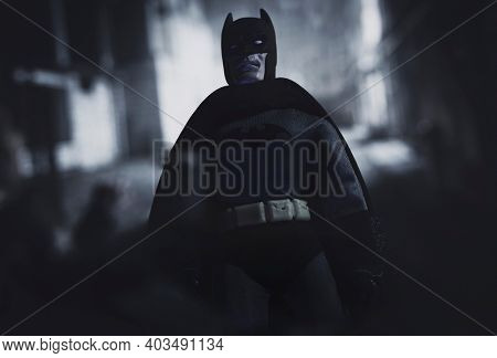 JAN 12 2021: Batman standing over a thug in a dark alley in Gotham City - Mego Corporation action figure