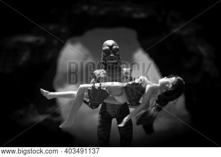 JAN 12 2021: recreation of the movie poster from A Creature From the Black Lagoon - black and white - Mego Corporation action figures