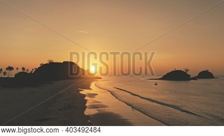 Sunset over mountains islands. silhouette Nobody nature seascape of ocean bay. Tropic landscape of sand beach. Summer scenery of Philippines, Asia. Cinematic soft drone shot
