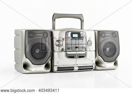 Vintage boom box radio, cd,  stereo cassette tape player and recorder on white.