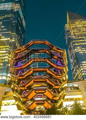 The Vessel And Two Skyscrapers Illuminated At Night At Hudson Yards In Midtown Manhattan. 1/17/2021
