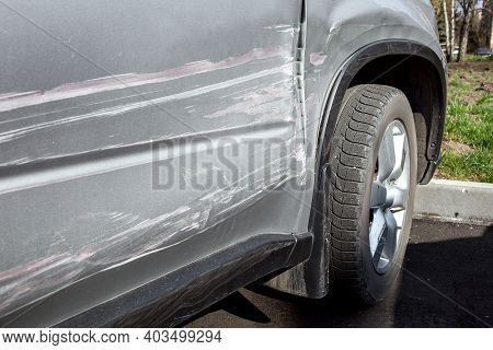 Details Of The Damage To The Car In The Incident, A Scratched Door And A Crumpled Fender Close Up Si