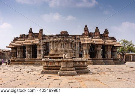 Hampi, Karnataka, India - November 5, 2013: Vijaya Vitthala Temple. Brownstone Main Sanctuary With M