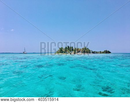 Sailboat Anchored Off A Beautiful Island In Belize Off The Belize Barrier Reef