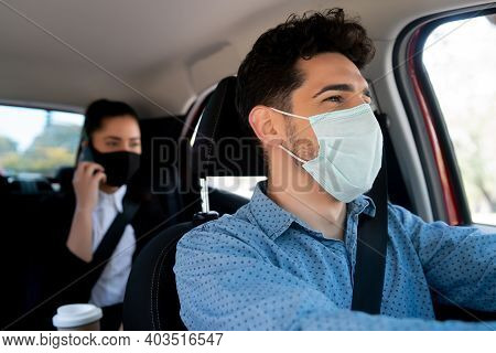 Portrait Of Young Male Taxi Driver With