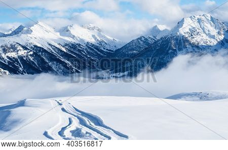 Mountain Ski Resort. Snowcat Trail On Snow Slope. Snowy Mountains. Ski Resort Landscape On Clear Sun