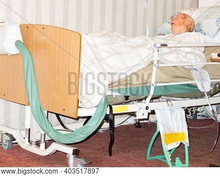 Elderly,frail Bed Ridden Man At His Home Living Room,hampshire,england U.k.