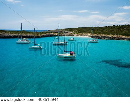 Sailing Boat Ship Yacht Anchored On Turquoise Blue Water Cala Varques Bay Mediterranean Sea Mallorca