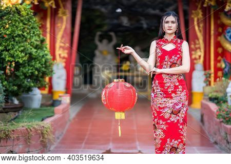 Asian Woman Wearing Red Traditional Chinese Cheongsam Decoration Hold Paper Lanterns With The Chines