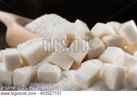 Refined Sugar And Sugar On A Dark Background. Sugar On Burlap