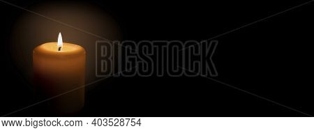 The Flame Of A White Candle On A Black Background. Banner With Space For Text.