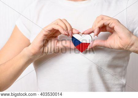 Love Czech Republic. The Girl Holds A Heart In The Form Of The Flag Of Czech Republic On Her Chest.
