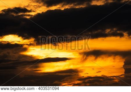 Golden Sunset Sky With Dark Clouds. Beauty In Nature. Beautiful Sunset Sky Abstract Background. Oran