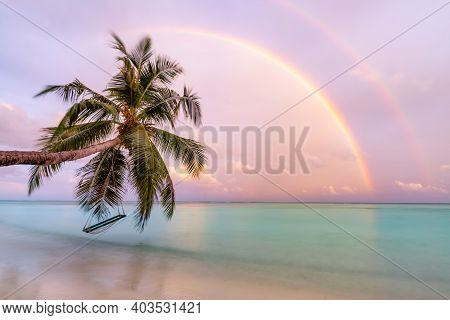 Picturesque Nature Landscape. Exotic Beach Sunset, Fantastic Rainbow And Colorful Sky. Calm Blue Sea