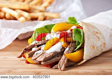 Mexican Fajita, Wrap Made Of Tortilla, Beef, Fresh Vegetables.