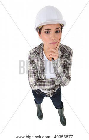 Portrait of an unsure tradeswoman