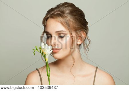 Beautiful Woman With Smelling White Flowers, Medicine, Skincare And Facial Treatment Concept