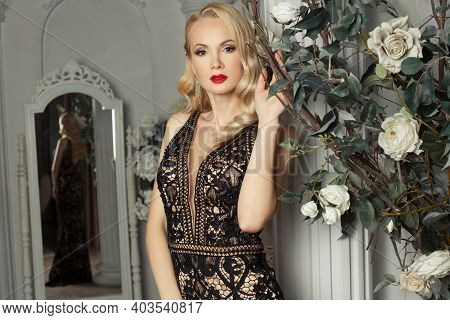Fashion Model Woman In Evening Gown With Rose Flowers