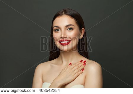 Fashion Model Woman With Red Nails On Black Background