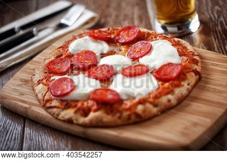 Pepperoni Pizza With Beer Glass. High Quality Photo.
