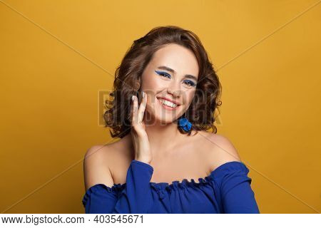 Lovely Woman Fashion Model Smiling On Yellow Background