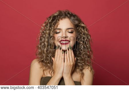 Beautiful Fashion Model Woman Showing Hands With Manicured Nails On Red Background